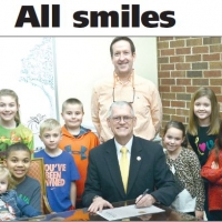 Dr. Sheets witnesses McAlester proclaiming the month of February as National Children's Dental Health Month