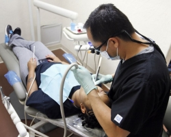 Dr. Michael Cheng Helps to Open Dental Clinic